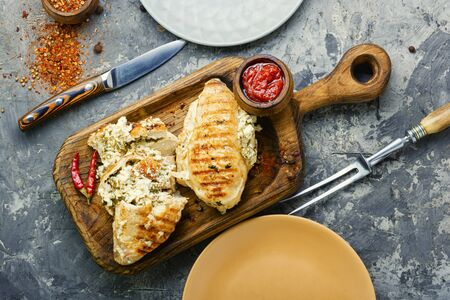 Baked chicken breast stuffed with cheese on kitchen board Stok Fotoğraf