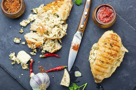 Grilled chicken breast stuffed with feta cheese and garlic. Stok Fotoğraf