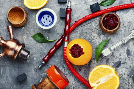 Details of tobacco hookah and tobacco with orange aroma. Stok Fotoğraf