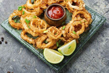 Crunchy deep fried squid rings in batter.Fast food Stok Fotoğraf