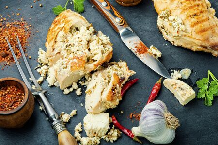 Baked chicken breast stuffed with cheese feta.