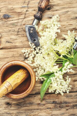 Elderberry inflorescences on a wooden table.Herbal medicine Stok Fotoğraf