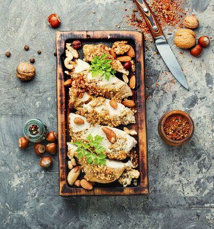 Chicken roll baked in breadcrumbs from nuts