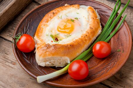 Khachapuri Georgian national flour product,pie stuffed with cheese and eggs