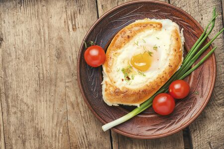 Adzharian khachapuri baked.Open pie with cheese and egg Stok Fotoğraf