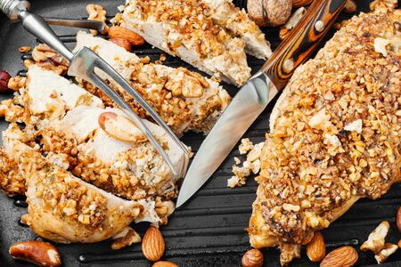 Baked chicken breast stuffed with various nuts in grill pan Stok Fotoğraf