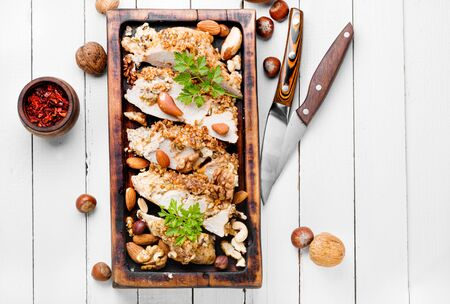 Roast chicken breast stuffed with nuts on white wooden background Stok Fotoğraf