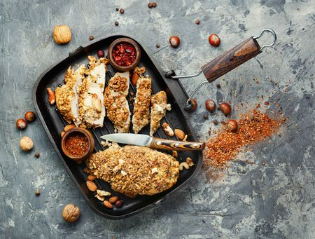 Roast chicken breast stuffed with walnuts and hazelnuts
