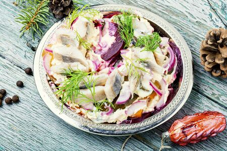 Appetizing salad with herring and vegetables.Russian cuisine.Traditional Ukraine salad herring under fur coat Zdjęcie Seryjne