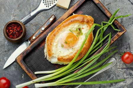 Adzharian khachapuri baked in the shape of a boat Stok Fotoğraf