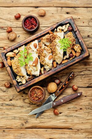 Roast chicken breast stuffed with walnuts and almond