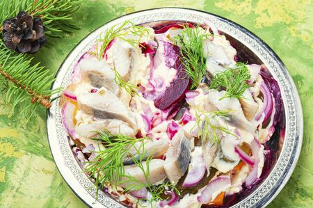 Appetizing salad with herring and vegetables.Seafood salad.Traditional Ukrainian salad.