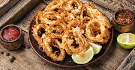 Crunchy deep fried squid rings in batter Zdjęcie Seryjne