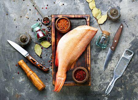 Whole raw fresh red perch or seabass.Raw red sea perch Фото со стока