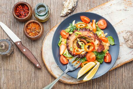 Thai salad with grilled octopus and fresh vegetables.Fresh healthy salad