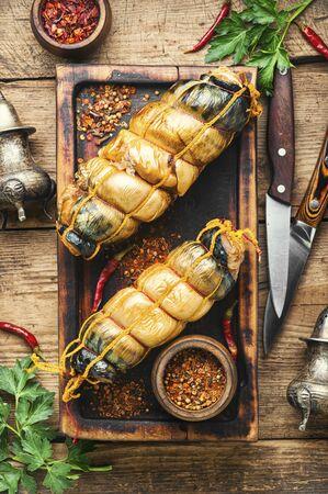Hot smoked mackerel roll.Delicious smoked fish on kitchen board Stock fotó