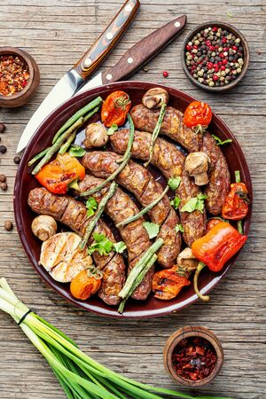 Delicious german sausages with grilled mushrooms and tomatoes Stock fotó