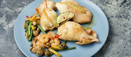 Squid stuffed with mushrooms, carrots and peppers. Stock fotó
