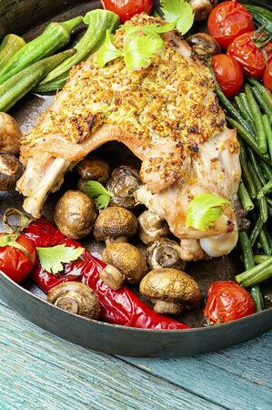 Roasted turkey with grilled vegetables on wooden table