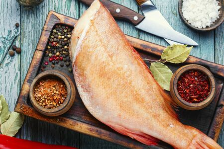Whole raw fresh red perch or seabass.Raw fish seabass on wooden background