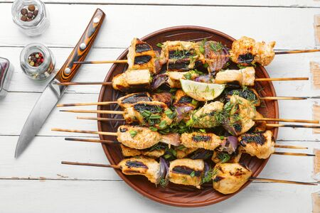Grilled chicken on bamboo skewers or chicken shashlik.Delicious turkey,chicken shish kebab skewer