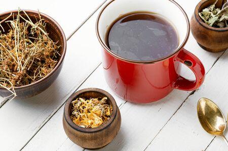 Healing herbs and herbal tea.Glass cup of green tea 写真素材