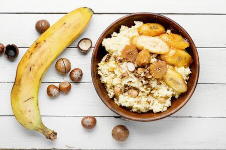 Millet porridge with caramelized bananas and nuts.Healthy breakfast