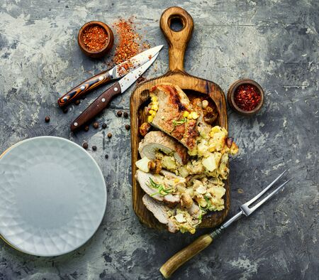 Stuffed meat with pineapple and cheese.Homemade meatloaf with mushrooms and cheese. Stockfoto