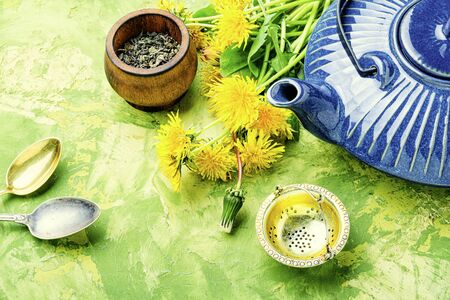 Fragrant herbal tea from flowering dandelions.Healthy dandelion tea.