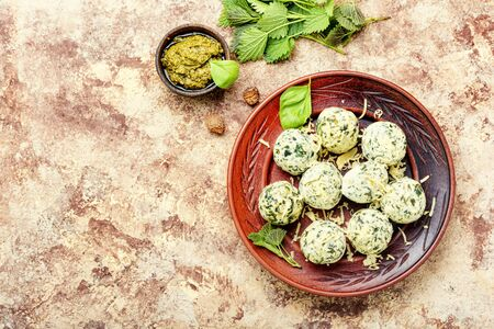 Curd dumplings or Malfatti with nettles, traditional Italian food.Space for text