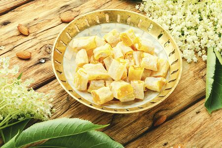 Traditional oriental sweetness,Turkish delight lokum with elderberry tasty.Turkish delight on wooden table.