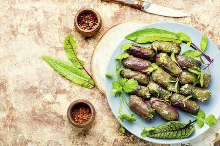 Traditional oriental dolma in sorrel leaf on table