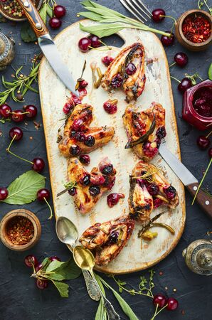 Baked chicken meat in a cherry sauce with herbs