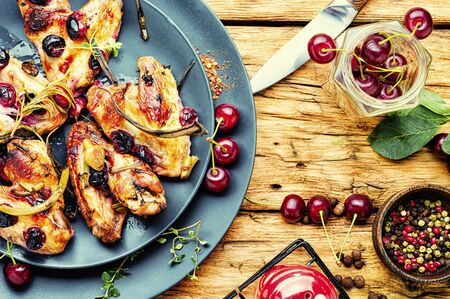 Fried chicken wings in spicy cherry sauce.Grilled chicken, fast food.