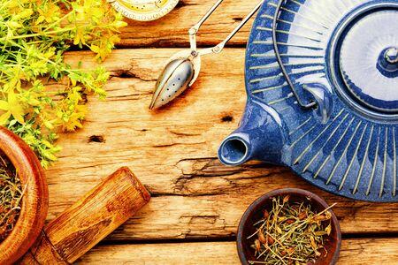 Fragrant useful herbal tea with hypericum.Herbal medicine.Tea with herbs.