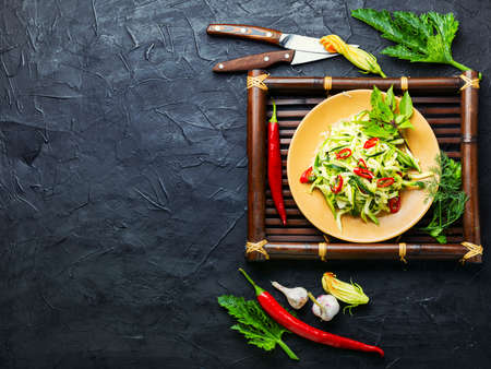 Summer salad of fresh zucchini, peppers and garlic.Vegetable salad.Copy space