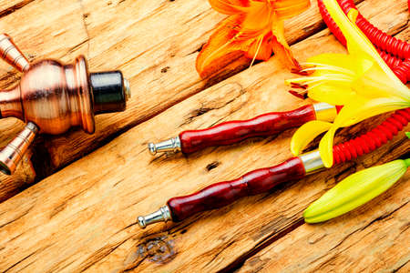 Asian smoking hookah with fragrant flower tobacco.Lily flavor shisha Stock Photo