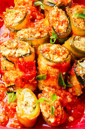 Baked zucchini or eggplant stuffed with cheese Imagens