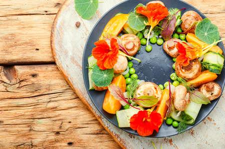Summer vegetable salad decorated with nasturtium flowers.Healthy vegetarian food Stok Fotoğraf