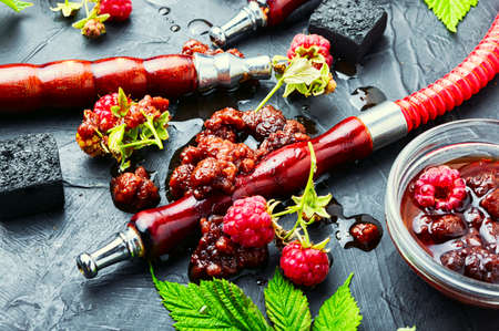 Oriental hookah with tobacco with the aroma of raspberry jam.Eastern shisha