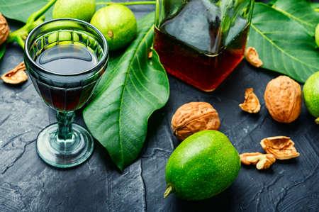 Liqueur made from unripe walnuts or nutcracker.Nocino in the glass, Italian liqueur