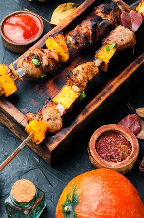 Kebab or skewers of meat and pumpkin.Tasty grilled kebab Stock Photo