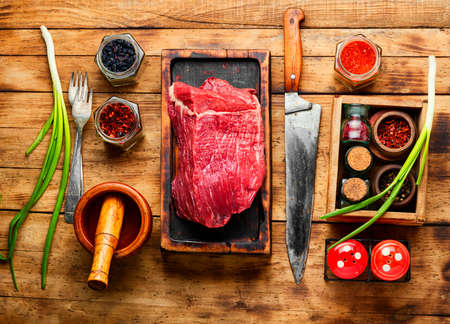Fresh raw beef meat on wooden cutting board