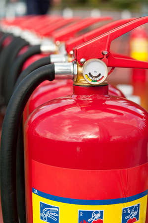 fire extinguishers: Group of ready fire extinguishers for use Stock Photo