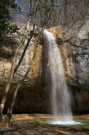A waterfall in a mountain forest Stock Photo