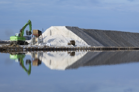 Excavator on a salt factory Stock Photo