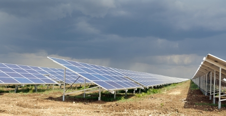 Solar panels for electricity and a cloudy sky Stock Photo