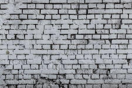 La textura de una pared de ladrillo quemado blanco antiguo, fondo