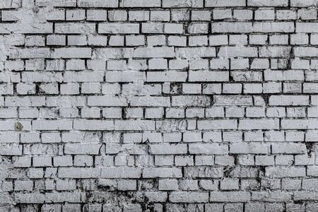 Texture of a wall made of old white burnt brick, background