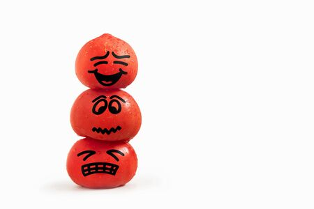 Cartoon ripe tomatoes on top of each other in the form of a tower on a white background 스톡 콘텐츠